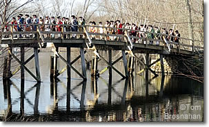 Minutemen march across Old North Bridge, Concord, Massachusetts