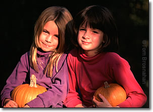 Girls with autumn pumpkins, New England
